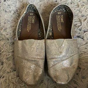 Silver glitter Tom's slip ons